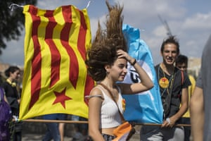 Students wave pro-independence flags while standing over an air vent as they demonstrate against the position of the Spanish government to ban the self-determination referendum of Catalonia.