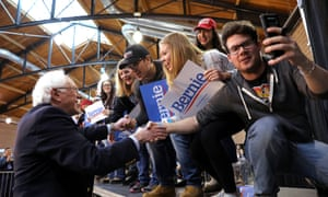 Bernie Sanders shakes hands with supporters during a campaign rally at the Iowa state fairgrounds in Des Moines.
