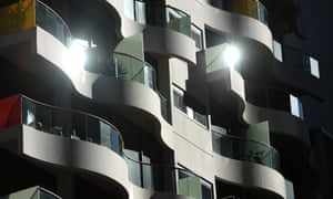 The sun reflects off an apartment building in Sydney