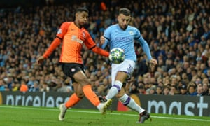 Manchester City's Nicolas Otamendi tangles with Shakhtar Donetsk's Tete in this season's Champions League group stages
