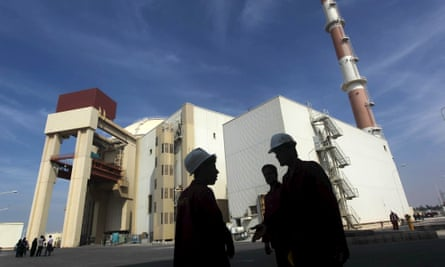 Iranian workers stand in front of the Bushehr nuclear power plant, about 1,200 km (746 miles) south of Tehran.