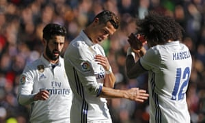 Cristiano Ronaldo celebrates with Isco and Marcelo after scoring the third.