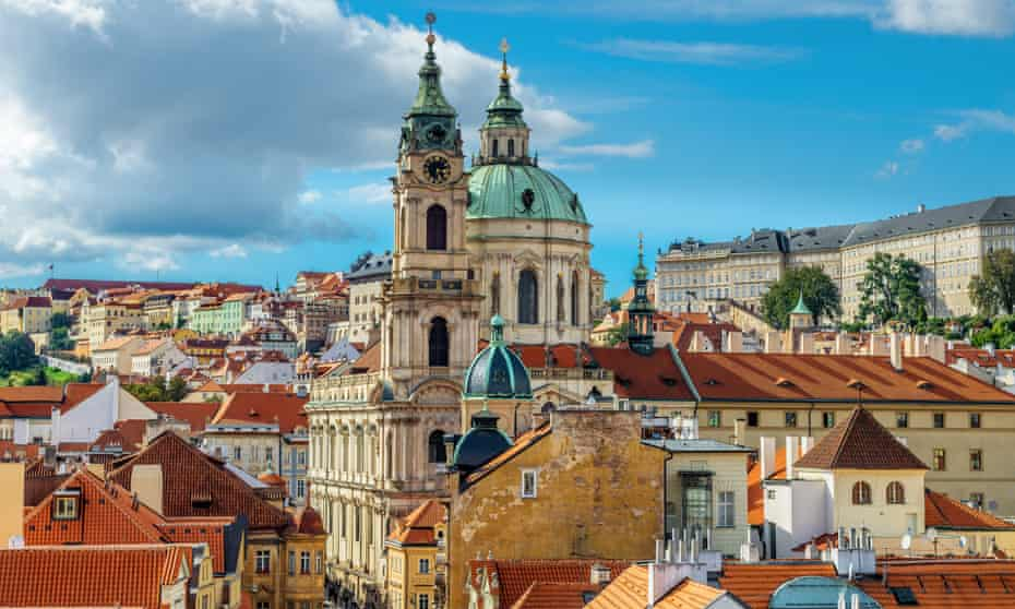 St Nicolas church and and roofs of Prague