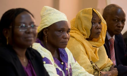 Survivors of Hissène Habré's regime, from right, Younous Mahadjir, Hadjo Amina Moctar and Ginette Ngarbaye, sit alongside lawyer Delphine Djiraibe, left, during a 2013 press conference in Dakar.