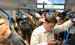 People on a delayed and crowded Thameslink train from London Blackfriars to Brighton