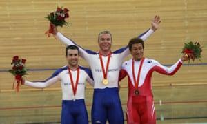 Japan's Kiyofumi Nagai stands alongside Britain's Ross Edgar (left) and Chris Hoy (centre) after the men's keirin final at the 2008 Olympics
