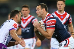 Boyd Cordner of the Roosters is tackled during the NRL Preliminary Final match between the Sydney Roosters and the Melbourne Storm at the Sydney Cricket Ground.