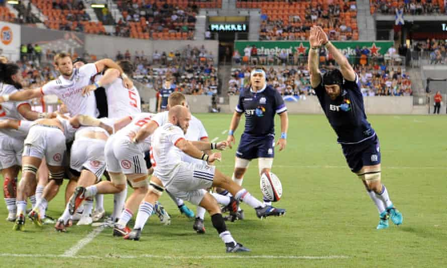 Shaun Davies, scrum-half for the Glendale Raptors and the USA, clears his lines against Scotland in Houston.