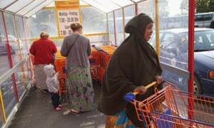 Refugees from Somalia and Chechnya housed in the German village of Vossberg visit a supermarket in nearby Letschin last October