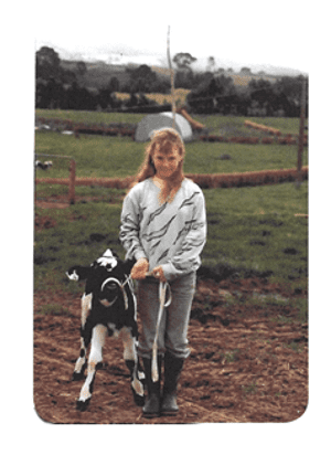 Angela tending to cows from her childhood days during the school holidays.