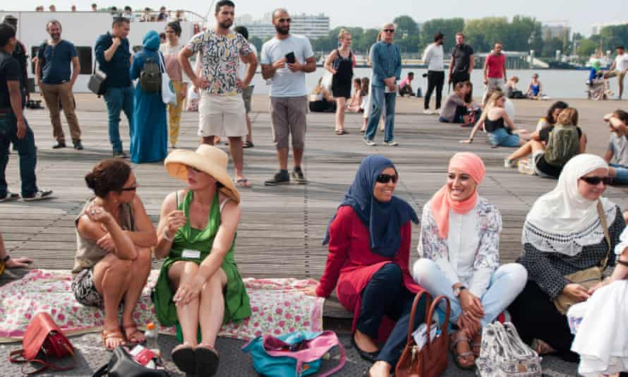 People in Antwerp hold a beach party this summer to protest at the burkini ban over the border in France.