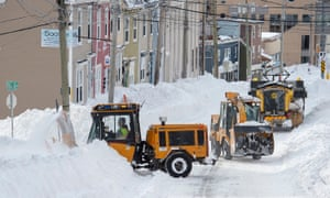 Workers with snow-clearing machinery in St John's, Newfoundland