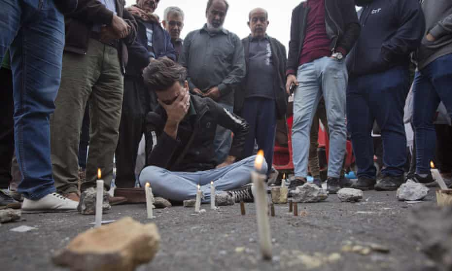 Demonstators hold a vigil in Khilani square yesterday after Friday night's bloodshed.
