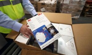 A box of face masks at an NHS warehouse