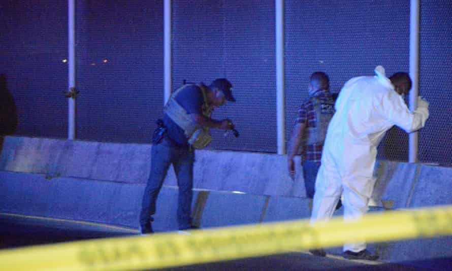 Police officers and a forensic technician work at the crime scene where a Mexican asylum seeker killed himself after being denied entry into the US at the Pharr-Reynosa international bridge on 8 January.
