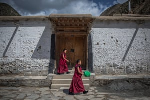 Young Tibetan Buddhist monks walk the grounds of the Labrang Monastery in Xiahe, an ethnically-Tibetan town in Gansu province, China