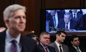 Senator Dick Durbin, on screen, questions Judge Neil Gorsuch about whether 'we should condemn or congratulate' Professor John Finnis for his legal opinion on gay sex.