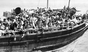Vietnamese refugees on wooden junks sail into Hong Kong, 1979.
