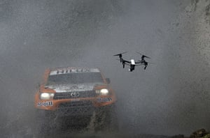 A drone flies in front of the Toyota's driven by Ronan Chabot and co-driver Gilles Pillot