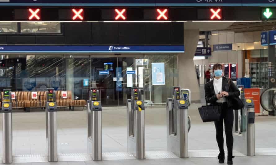 A rail user passes through the gates at London Bridge station