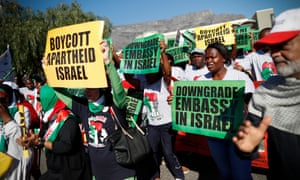 South Africans take part in a protest against Israel in Cape Town, South Africa on Tuesday. South African Jews for a Free Palestine joined the human rights and Palestine solidarity movement Boycott, Divestment and Sanctions against Israel in South Africa in marching to South Africa's parliament in protest against the Israeli governments actions in Gaza