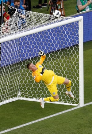 England's Jordan Pickford makes an early save from a long-range strike by Youri Tielemans.