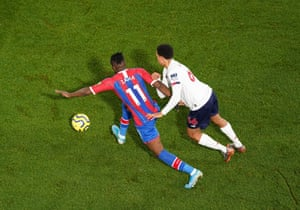 Crystal Palace's Wilfried Zaha is tugged back by Liverpool 's Trent Alexander-Arnold of Liverpool as the league leaders win 2-1 at Selhurst Park.