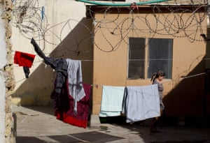An inmate walks past in the courtyard at the Mazar-i-Sharif women's prison, where many are detained for 'moral crimes'.
