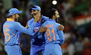 India celebrate the wicket of Usman Khawaja.