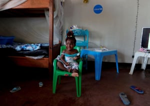 Chamim, whose mother recently died of Ebola, cries at a Unicef centre for children whose families have or are suspected of having the disease, in Beni