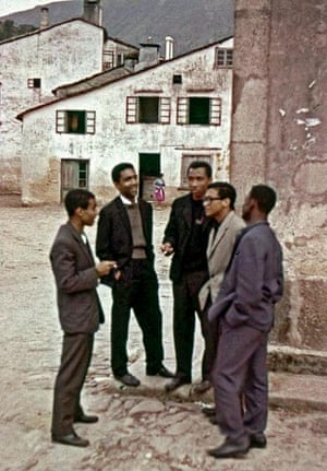 Making plans: five students enjoy a smoke after fleeing from Portugal.
