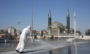 Workers clean and disinfect surfaces in Taksim Square, Istanbul.