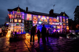 Families admire the festive decorations on Sheila and John Gill's home in Stow Hill, Newport, after the couple opened up their home to visitors over the festive season