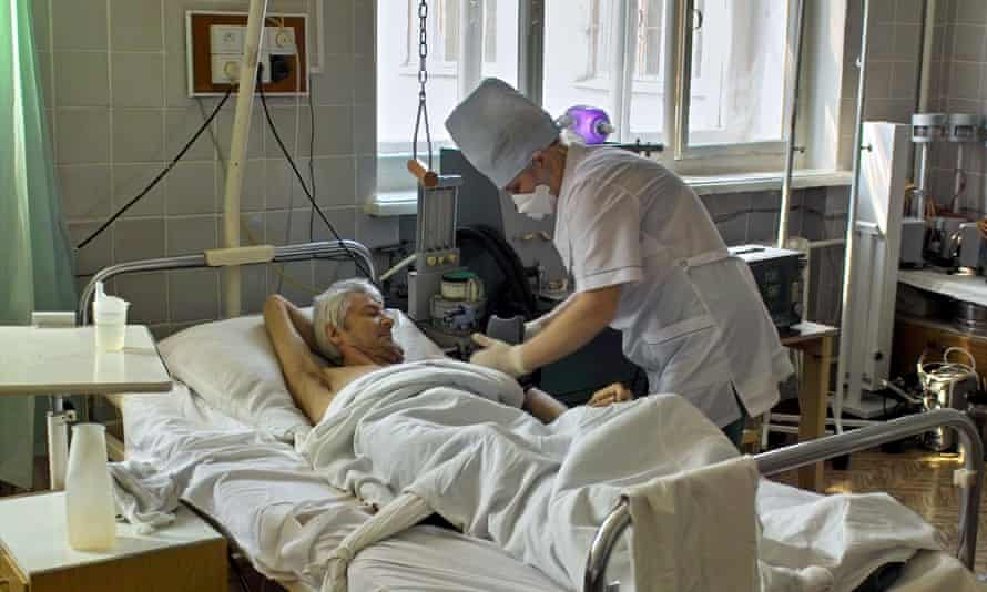 A tuberculosis patient having his blood pressure measured in eastern Siberia