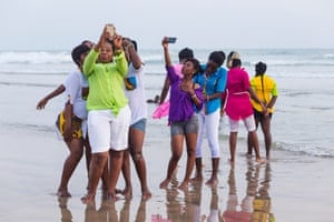 A group of young women stop to take selfies while strolling on Labadi beach, a popular hang out in Ghana's capital. The photo forms part of a project by Tripod City, a photographic collaboration between Charlie Kwai, Chris Lee and Paul Storrie, who visited the country to capture contemporary Ghanaian culture.