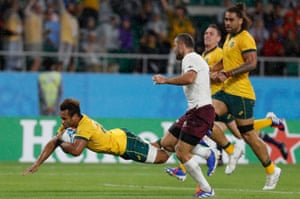 Australia's scrum-half Will Genia dives over to score a late try.