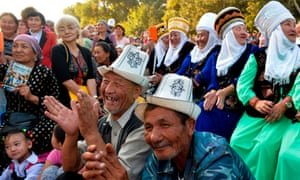 Residents of the town of Tokmok attend a meeting with the opposition candidate Omurbek Babanov