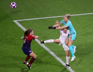 Ellen White of England collides with Ingrid Hjelmseth of Norway.