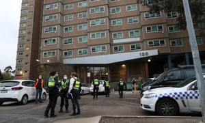 Police at one of the nine public housing towers in Flemington, Melbourne, placed under 'hard lockdown' on Saturday afternoon