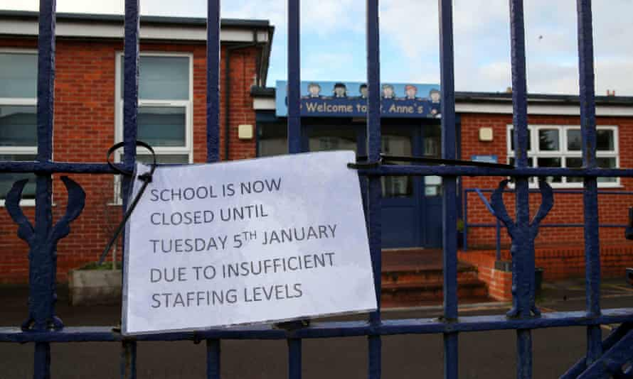 A sign hangs on the gate of St Anne's Catholic Primary school in Caversham, Reading, informing parents that the school is closed due to insufficient staffing levels.