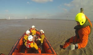 Sara coastguard officers undergoing helicopter training on the Severn estuary.