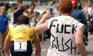 A fan wearing a T-shirt reading 'Fuck Bush' runs after Lance Armstrong in the Tour de France.