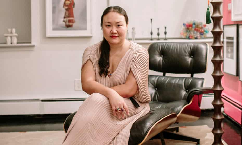Hanya Yanagihara sitting in a leather chair in her Soho apartment