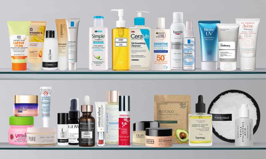 Beauty products on two bathroom cabinet shelves