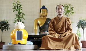 Master Xianfan with his robot monk Xian'er, at the Longquan Buddhist temple on the outskirts of Beijing.