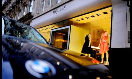 A sports car parked outside fashion designer Alexander McQueen's shop in Bond Street, London