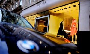 A sports car outside an Alexander McQueen shop in London