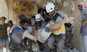 White Helmets rescue an injured man after an airstrike in Idlib, Syria.