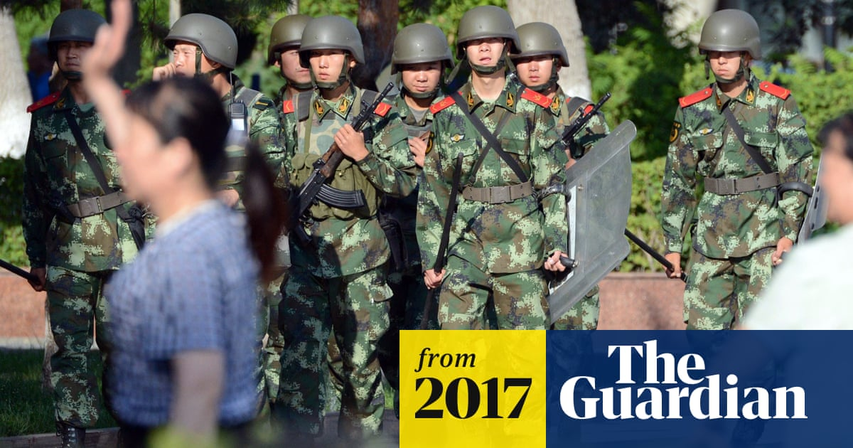 Chinese troops stage show of force in Xinjiang and vow to