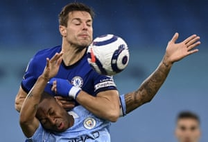 Manchester City's Raheem Sterling and Chelsea's Cesar Azpilicueta challenge for the ball.